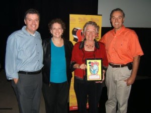 George Menedez Rae's niece Mary Beyers shows off his Joe Shuster  Hall of Fame award with her children (from left to right)  Chris Beyers, Diana Coen and Rick Beyers.